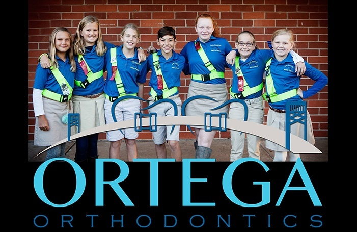 Group of kids with braces smiling