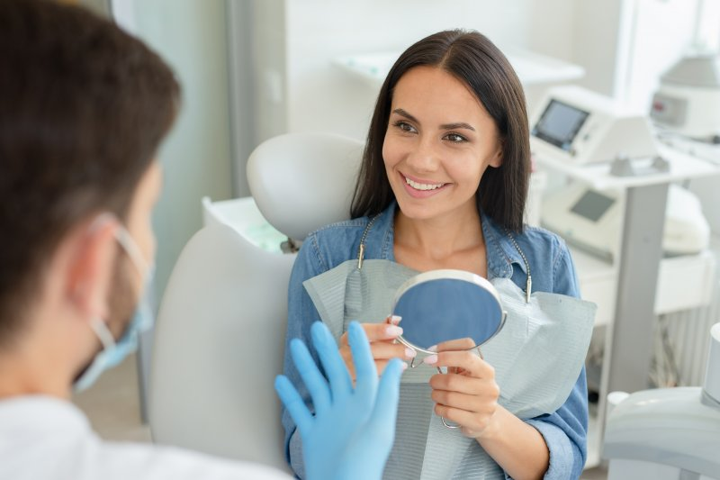 Woman smiling while talking to orthodontist