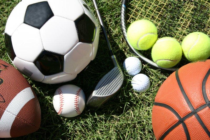 Assortment of different sports balls on field